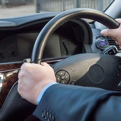 a man holding the wheel